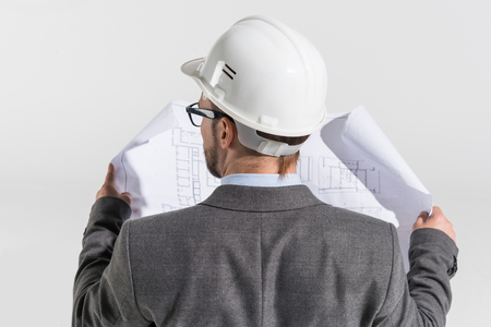 schemes: back view of disabled architect in wheelchair with blueprint Stock Photo