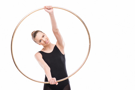 happy attractive rhythmic gymnast in black leotard holding hoop