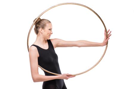 attractive smiling rhythmic gymnast in leotard posing with hoop Stock fotó