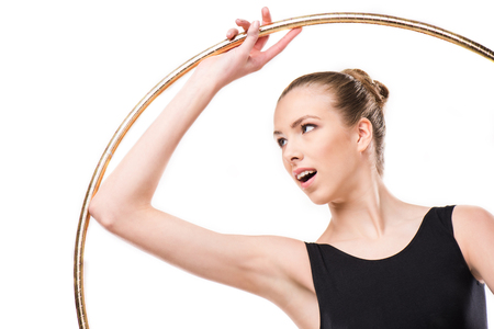 attractive excited rhythmic gymnast in leotard with hoop