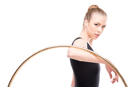 attractive rhythmic gymnast in bodysuit holding hoop and looking at camera Stock fotó