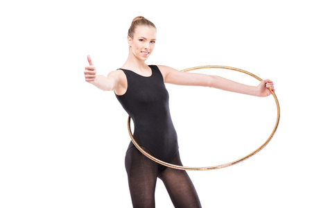 attractive rhythmic gymnast in leotard with hoop showing thumb up