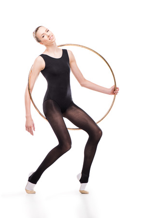 attractive rhythmic gymnast in bodysuit posing with hoop