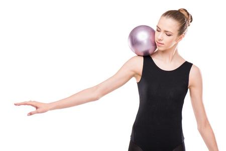 attractive rhythmic gymnast in leotard training with ball