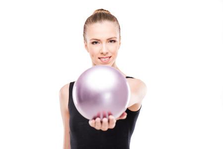 attractive rhythmic gymnast in leotard giving ball