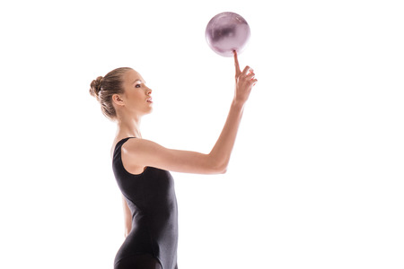 Beautiful young rhythmic gymnast exercising with ball Stock fotó
