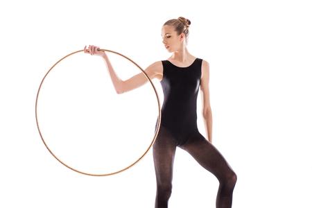 young sportswoman in bodysuit doing rhythmic gymnastics exercise with hoop Stok Fotoğraf