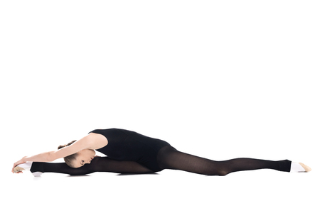 Athletic young rhythmic gymnast in sportswear stretching Stock fotó