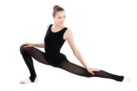 mujer deportista: joven, sonriente, mujer, sportswear, estirar, mirar, lejos Foto de archivo