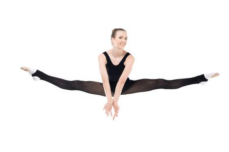 Smiling young sportswoman exercising rhythmic gymnastics Stok Fotoğraf