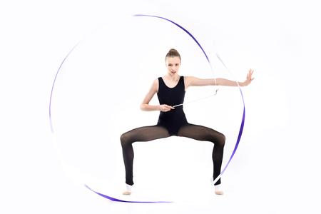 Attractive young rhythmic gymnast in leotard training with blue ribbon 版權商用圖片