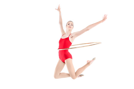 Sportive rhythmic gymnast training with hoop on waist