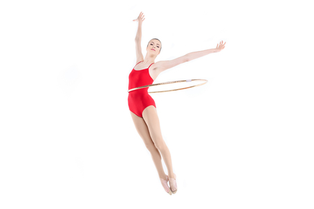 Sportive rhythmic gymnast training with hoop on waist