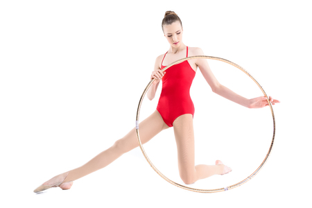 focused rhythmic gymnast training with hoop
