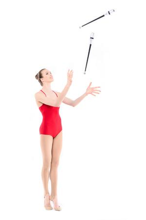 fit rhythmic gymnast training with clubs