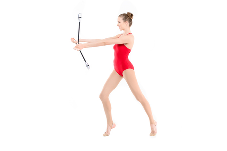 side view of rhythmic gymnast training with clubs