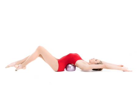 fit rhythmic gymnast training with gym ball