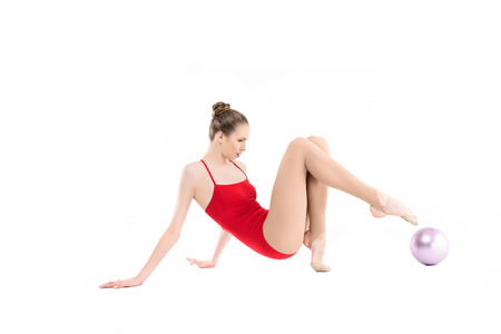side view of rhythmic gymnast training with gym ball Stock fotó