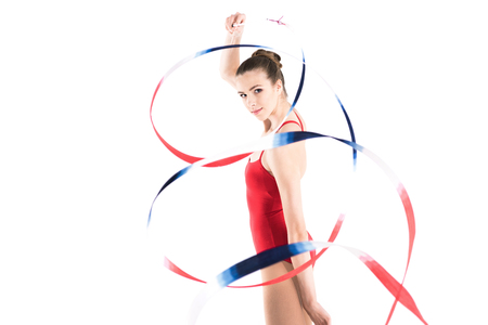 woman rhythmic gymnast exercising with colorful rope and looking at camera Stock fotó