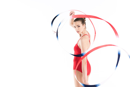 young caucasian woman rhythmic gymnast exercising with rope and looking at camera Stock fotó