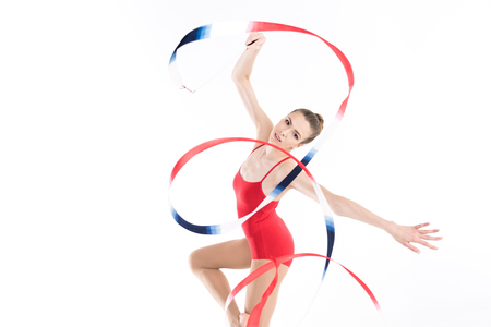 woman rhythmic gymnast performing with colorful rope and looking at camera Stock fotó
