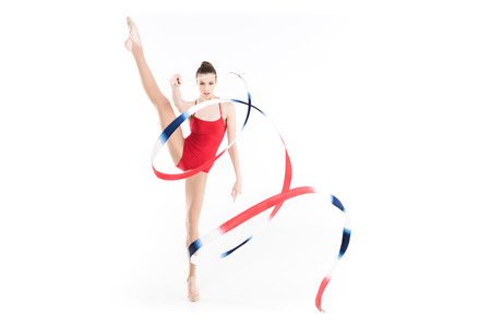 caucasian woman rhythmic gymnast performing with colorful rope