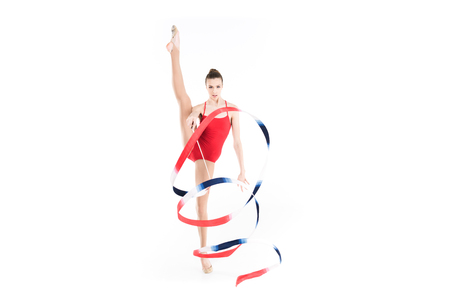 caucasian woman rhythmic gymnast training with colorful rope