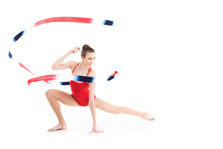 woman rhythmic gymnast stretching with colorful rope and looking away