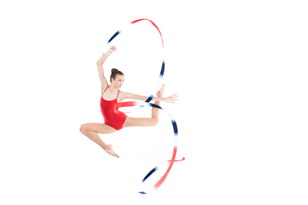young caucasian woman rhythmic gymnast jumping with rope Stock fotó
