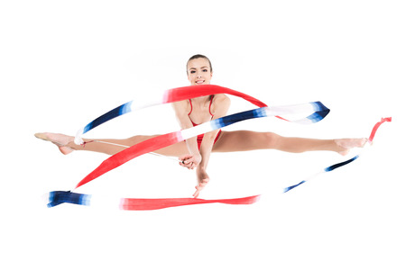woman rhythmic gymnast jumping with rope and looking at camera Stock fotó