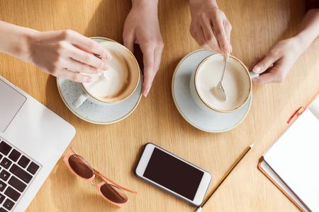 partial: women drinking coffee on coffee break Stock Photo