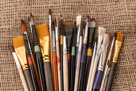 various paintbrushes collection on sackcloth