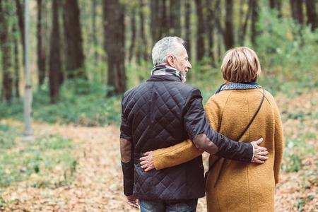 Mature couple walking in autumn park 스톡 콘텐츠
