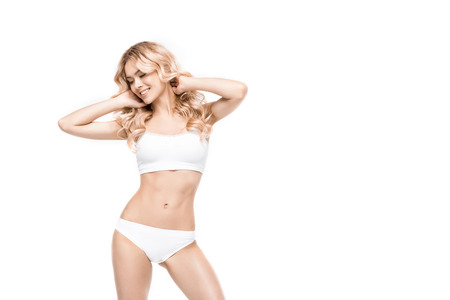 attractive smiling woman standing in white underwear