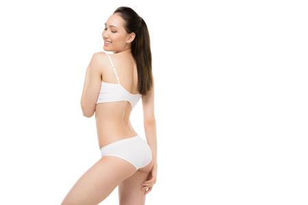 elegant asian girl posing in white underwear isolated on white