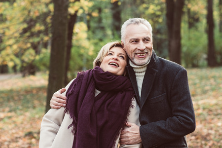 Smiling mature couple in park