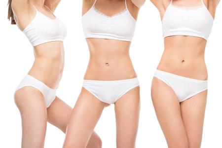 vrouwen in wit ondergoed poseren geïsoleerd op wit Stockfoto
