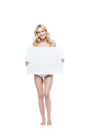 young blonde woman in lingerie holding blank card and looking at camera