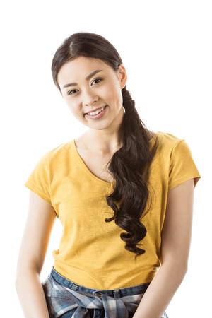 白で隔離笑顔アジア少女 写真素材