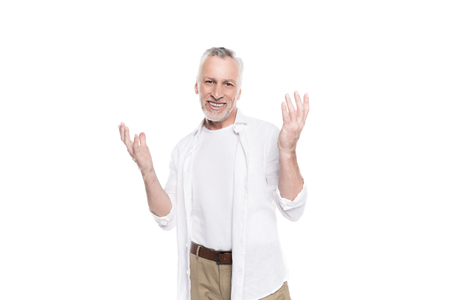 mature man gesturing with raised hands isolated on white
