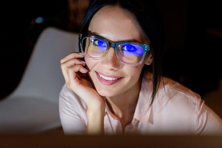 smiling caucasian businesswoman in glasses looking at camera