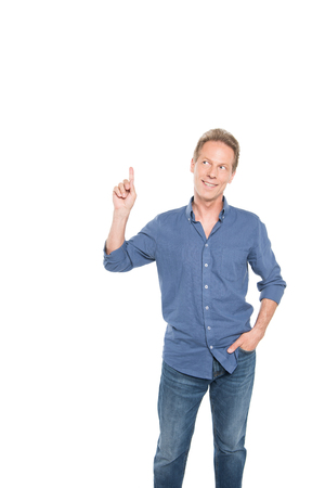 middle aged man pointing up and posing isolated on white