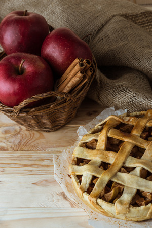 homemade apple pie and fresh organic ingredients in basket