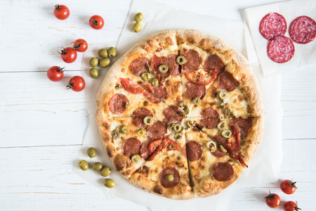 top view of homemade italian pizza with various fresh ingredients