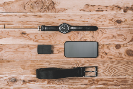 top view of smartphone, belt, lighter and hand watches Stok Fotoğraf