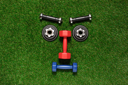 Top view of various dumbbells and weight plates