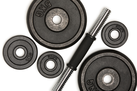 Top view of heavy weight plates with iron bar