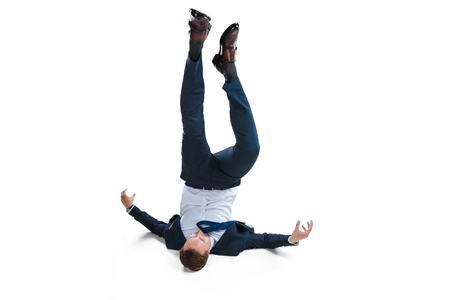 young businessman in suit falling upside down Stockfoto