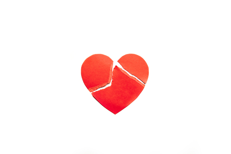 Red heart broken on little pieces isolated on white