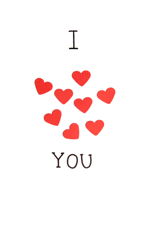 I love you, I heart you. Hand drawn inscription with group of red hearts isolated on white